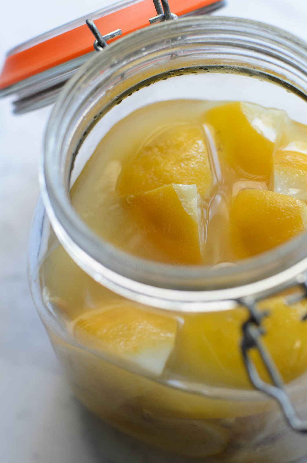 preserved lemons in a jar, ready for consumption photo