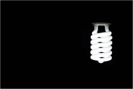 an eco-friendly light bulb glowing in the dark