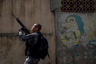 At least seven die in Rio police shootout as army takeover drags on