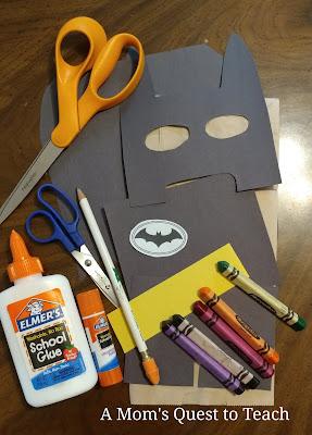 Batman paper bag puppet supplies; scissors, glue, construction paper