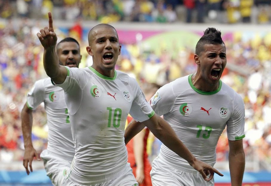 Algeria's Sofiane Feghouli, left, celebrates after scoring the opening goal during the group H World Cup soccer match between Belgium and Algeria at the Mineirao Stadium in Belo Horizonte, Brazil, Tuesday, June 17, 2014.