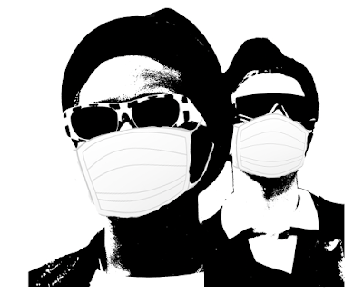 Two rude boys with pork pie hats and sunglasses are shown wearing surgical masks.
