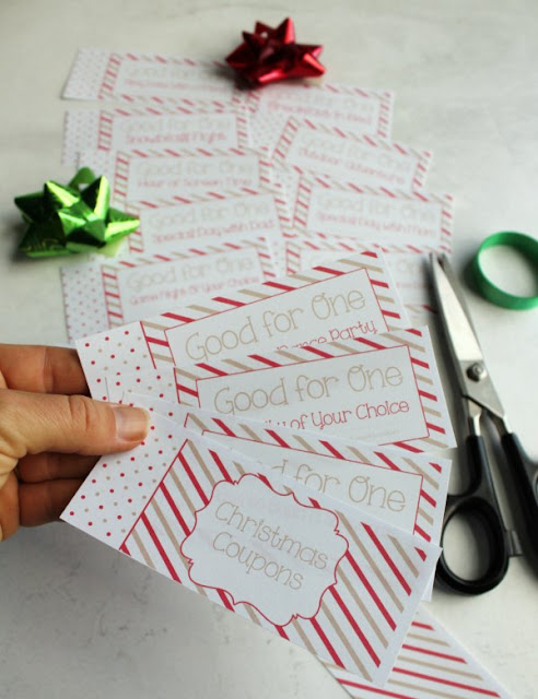 cutting out free printable pages to make a kid's coupon book for Christmas