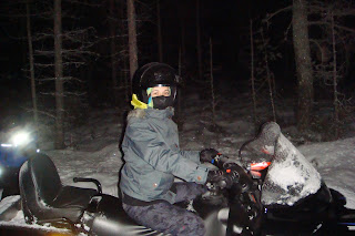 Riding snow mobile