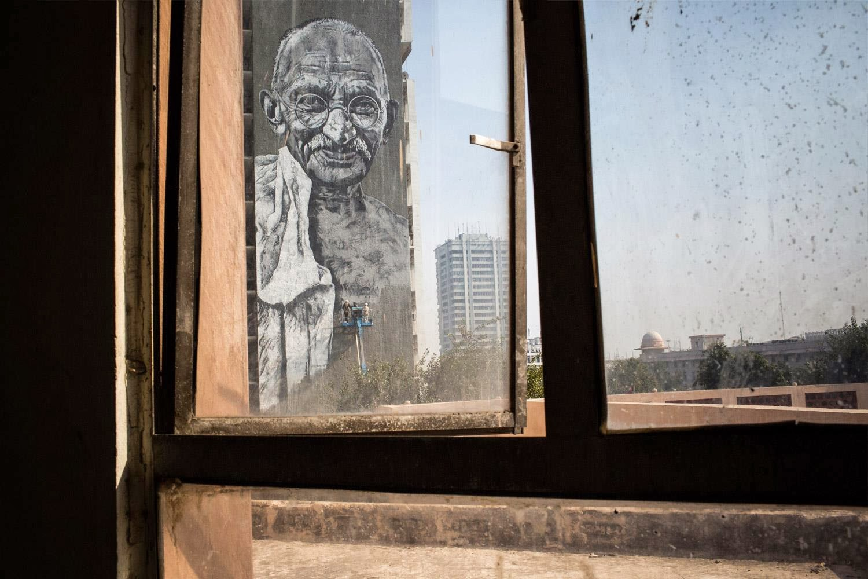 "German Artist ECB Paints a new street art mural of ""Gandhi"" on the streets of New Delhi, India. 2"
