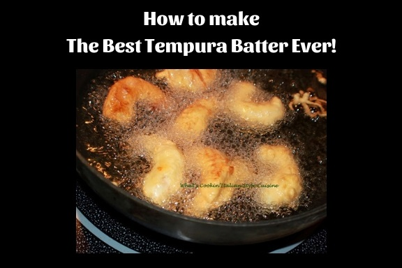 this is deep fried shrimp coated with tempura batter in a cast iron skillet with oi