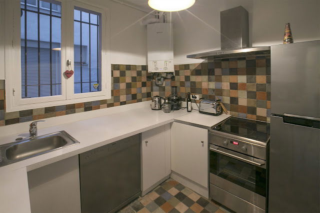Small kitchen in Paris apartment rental on private Avenue Frochot seen on Hello Lovely Studio