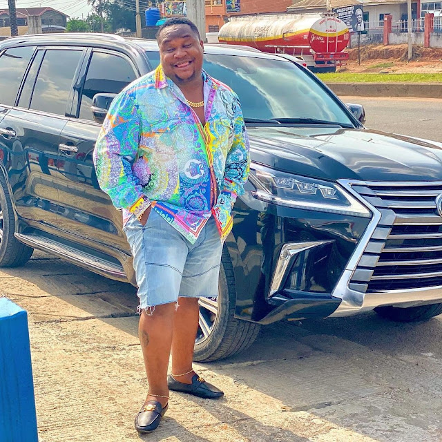 'Unbothered Lesbian In Versace' - Cubana Chiefpriest Poses With Multi-Million Naira Prado Jeep