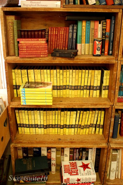 a bookcase full of vintage Nancy drew books