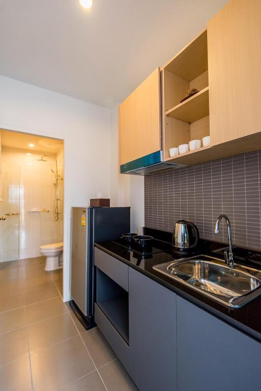 hill myna condotel review phuket nice and cheap studio kitchen toilet