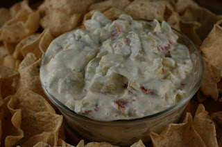 Sundried Tomato slow cooker dip. Uses flavored philadelphia cream cheese, artichoke hearts, and sun dried tomatoes