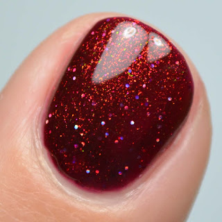 deep red nail polish with aurora shimmer