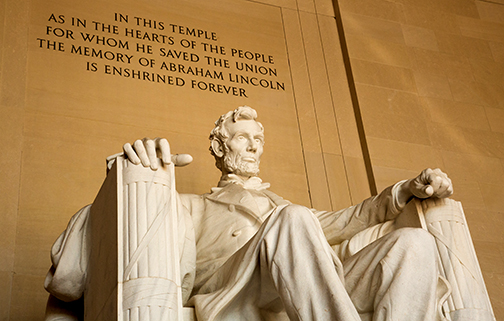 close up photo of Lincoln Memorial in Washington D.C. Text: In this temple as in the hearts of the people for whom he saved the union the memory of Abraham Lincoln is enshrined forever