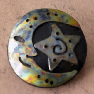 Moon and star brooch in the New Age style