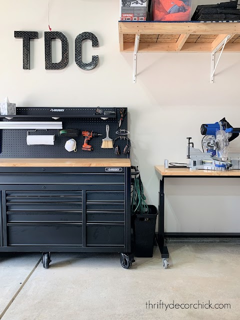 black and wood rolling tool benches