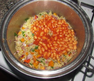 baked beans in a pot of noodles