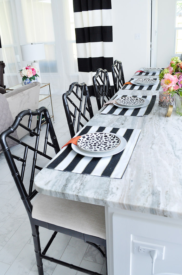 A review of the Dayna counter stools from Ballard Designs in the worn black finish. They look beautiful in this white and chrome glam kitchen. | via monicawantsit.com