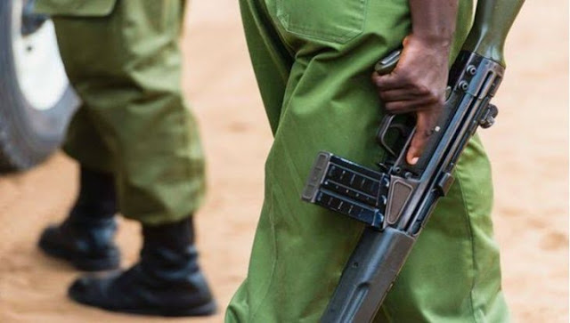 Police officer with a gun in Kenya