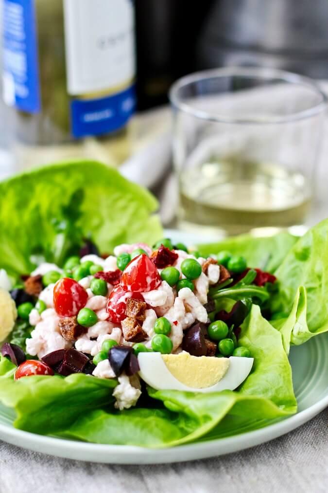 Bibb lettuce topped with shrimp salad and hard boiled eggs