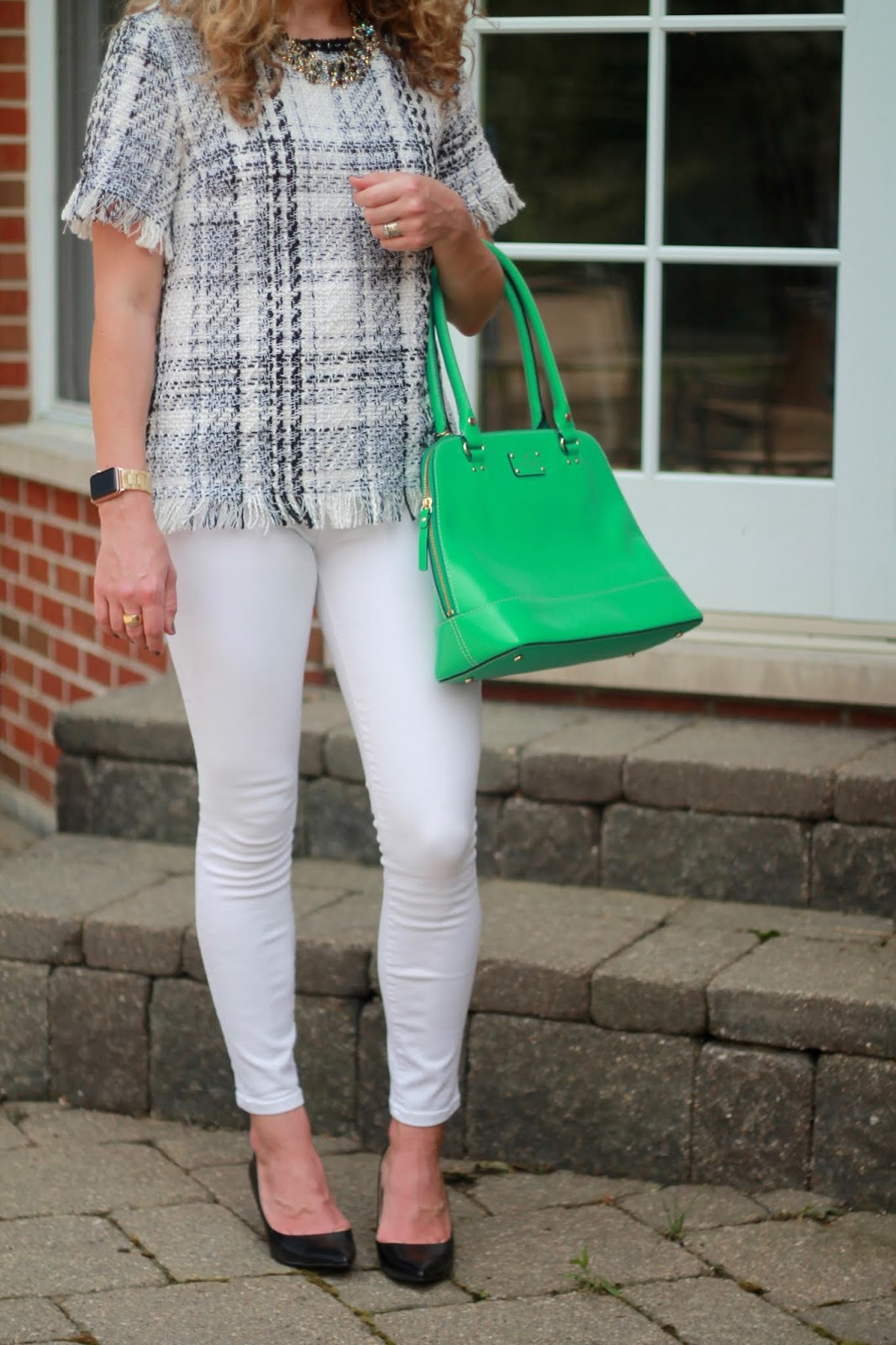 black and white tweed plaid top, white denim, green kate spade bag, statement necklace, black pumps