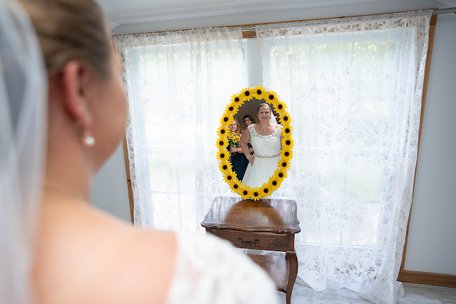 Bride looking at mirror with sunflowers Magnolia Manor Wedding Photos by Stuart Wedding Photographer Heather Houghton Photography