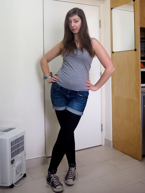 Hiking | outfit of light grey top, denim shorts, black leggings and high-top Converse