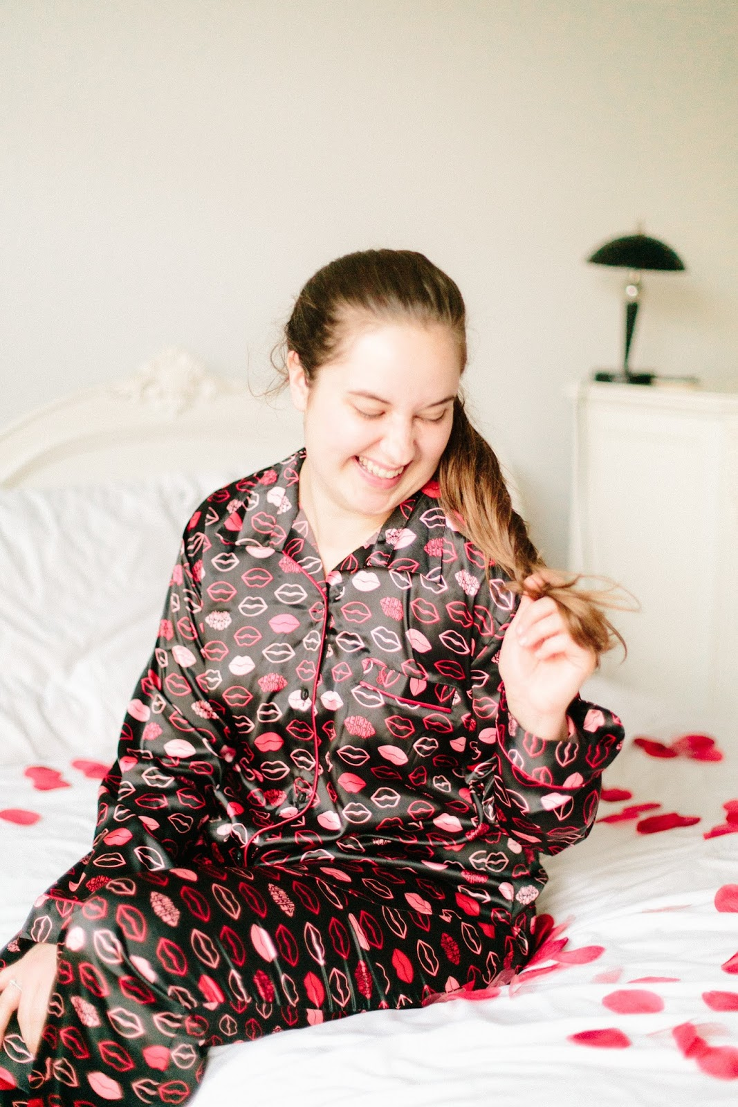 Girl wearing kiss print satin Victoria's Secret Valentine's Day pajamas