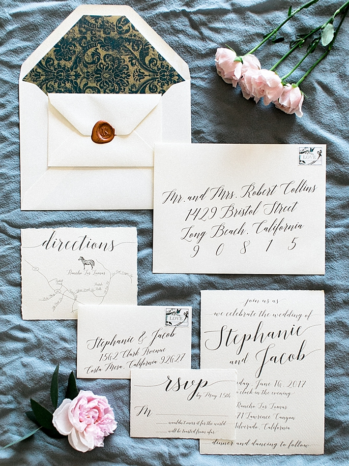 Calligraphy wedding invitations | Photo by Dennis Roy Coronel | See more on thesocalbride.com