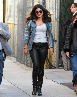 Priyanka Chopra in a white Skin Tight T Shirt and Leather pants with Denim jacket at Jimmy Kimmel Live show January 2017