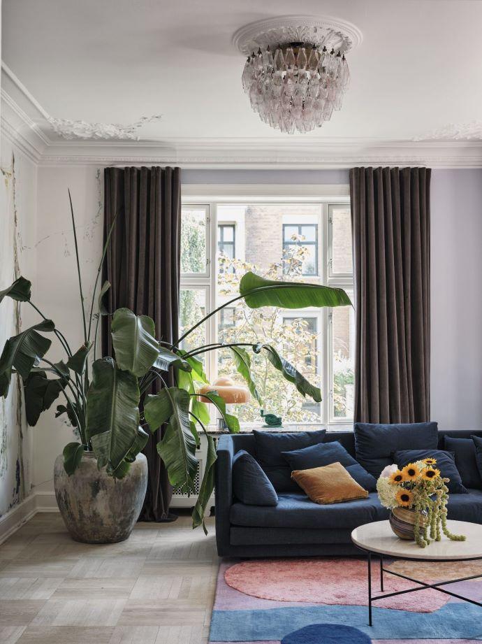 Oversized plant in gorgeous living room-designaddictmom