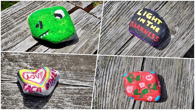 Hand painted rocks on a boardwalk...