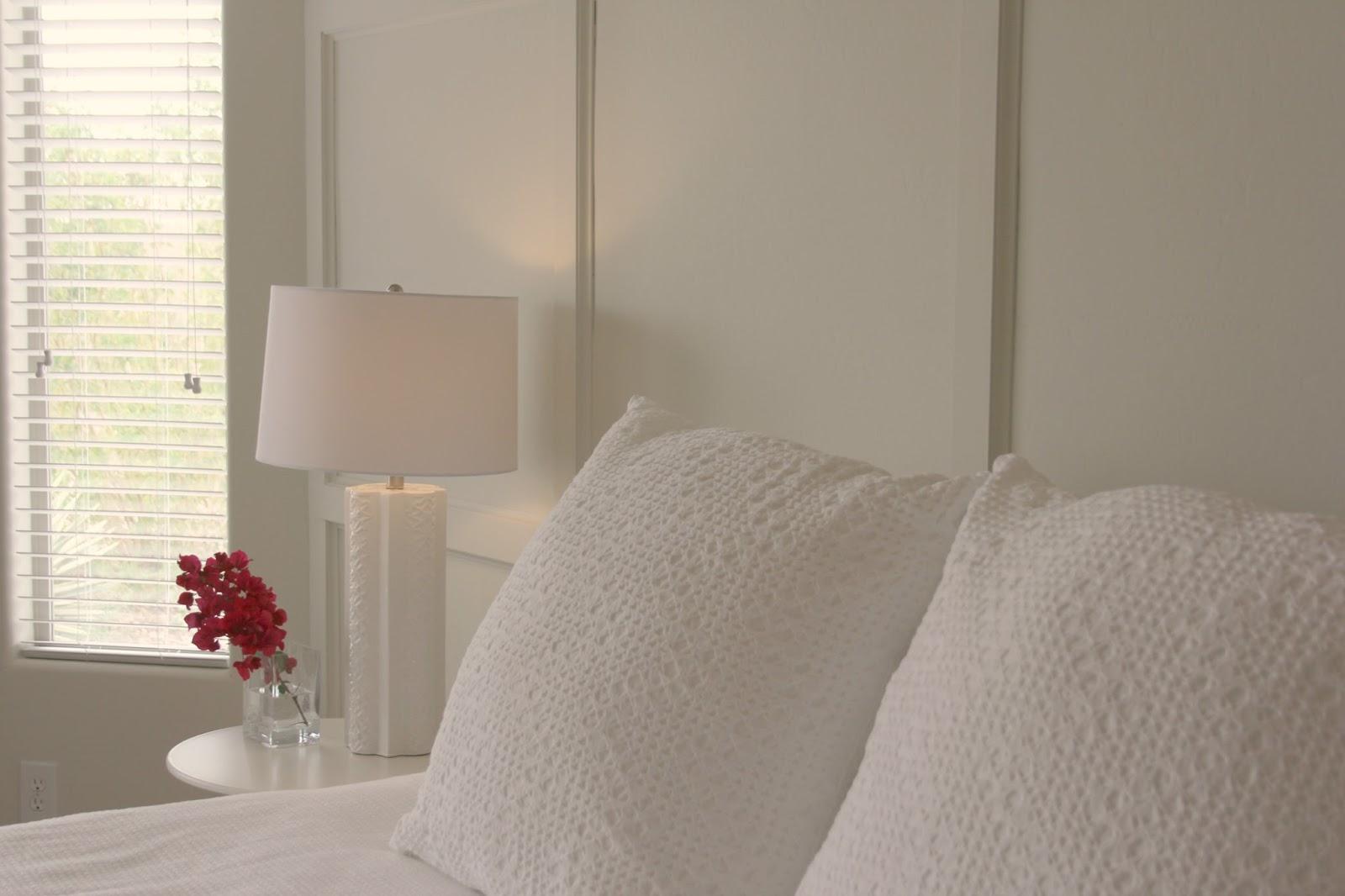 White eyelet pillow shams in serene master bedroom - Hello Lovely Studio