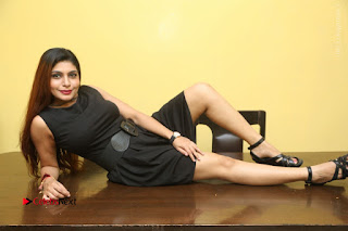 Tollywood Upcoming Actress Pooja Roshan Stills in Black Short Dress at Plus 1 Movie Trailer Launch  0358.JPG