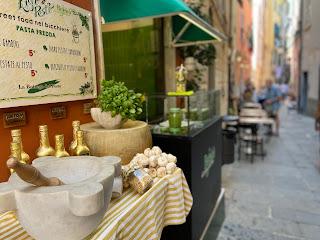 Portovenere street scene with giant pestle and mortar for making pesto