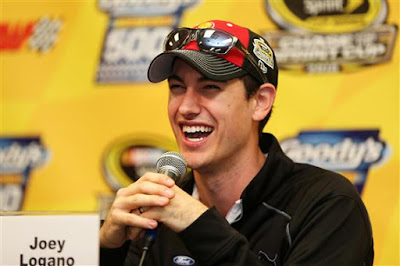 Joey Logano, driver of the #22 Shell Pennzoil Ford,  speaks to the media at Martinsville Speedway
