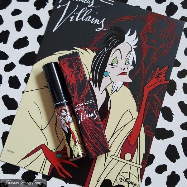 MAC Cruella De Vil lipgloss on spotty background and Cruella postcard