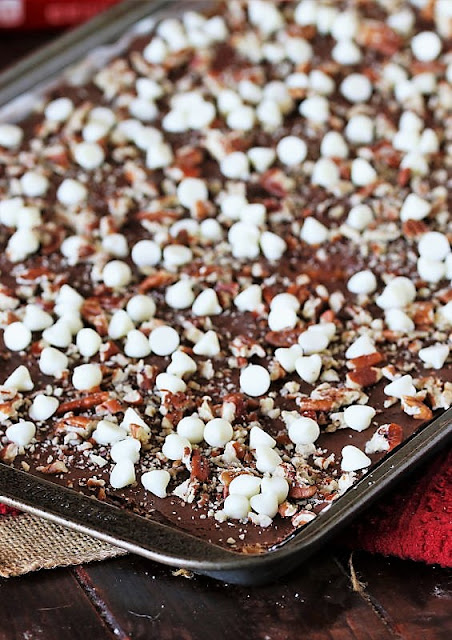 Ritz Cracker Candy with White Chocolate Chips and Pecans in Baking Pan Image