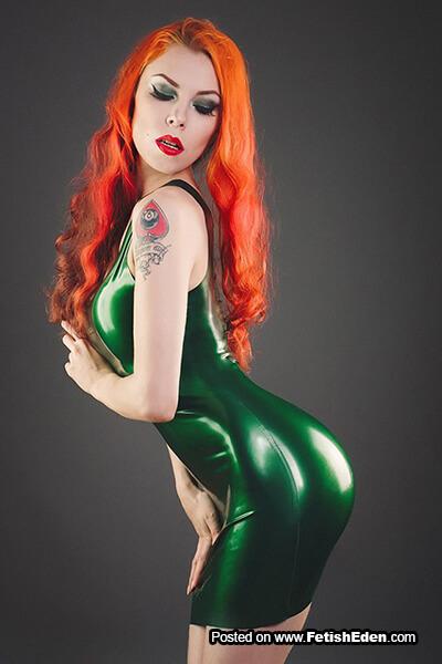 Annet Morningstar tattoo redhead wears tight green latex mini-dress