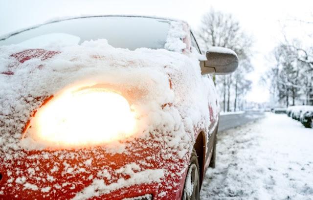 car in winter snow