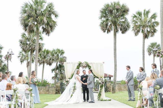 bride and groom at altar with pine trees surrounding