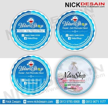 Contoh Desain Logo Olshop Biru Tema Doraemon dan Cetak Stiker Label - Percetakan Tanjungbalai