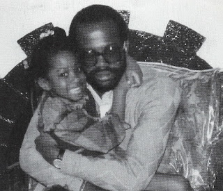 Jenee Darden as a toddler sitting in dad Christopher Darden's lap