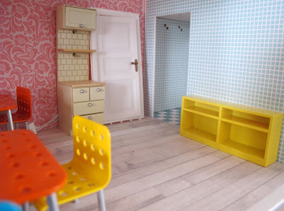 Interior of the ground floor of a half-built Lundby dolls' house.