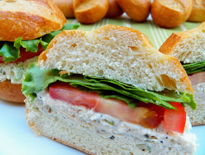 A Sliced Chicken Salad Sandwich with Garlic and Herbs Cheese