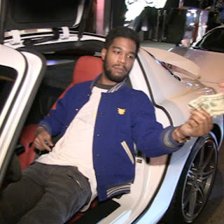Jacqueline Munyasya's ex-boyfriend Kid sitting inside the car and showing some money