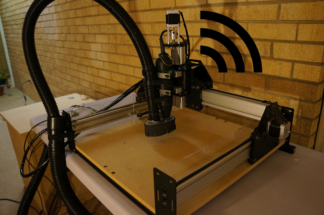 CNC machine with Wi-Fi symbol emanating from spindle