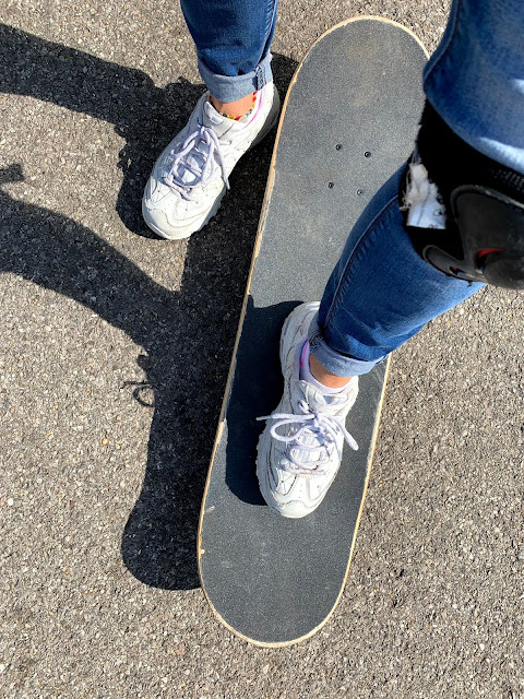 feet on skateboard