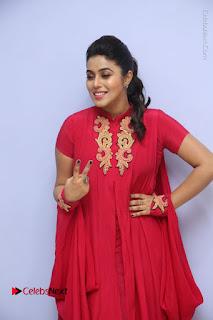 Actress Poorna Latest Stills in Red Dress at Rakshasi First Look Launch  0047.JPG