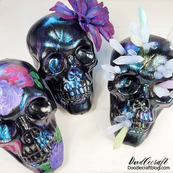I love how they kind of have a sugar skull vibe!  Iridescent skulls decorated 3 ways! Which one is your favorite? Or would you just leave them as iridescent skulls?