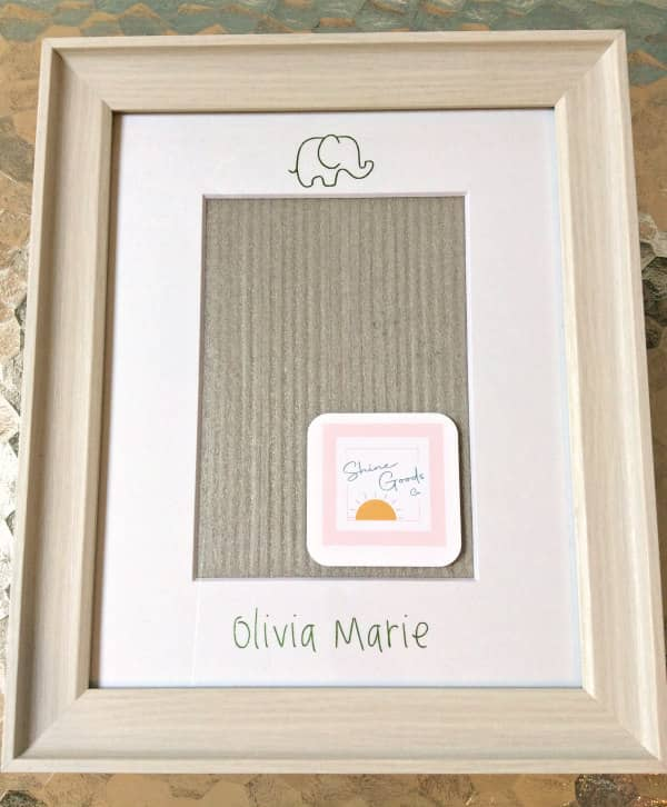 framed personalized foil transfer mat features baby elephant outline and baby's name in light green foil printing